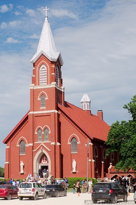St. John Nepomucene Catholic Church, dedicated in September of 1915. The tower with its height of around 120 ft/ 36m serves as a landmark in flat Kansas surroundings.